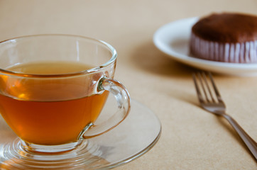 Glass Cup of Tea and Chocolate Cake for Tea Break.