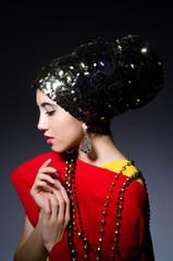 Woman in fashion concept in dark studio