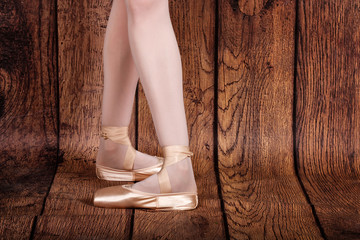 Fourth position in classical ballet. Ballet pas. Legs of balleri