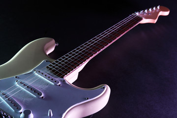 Electric guitar, on dark lighted background