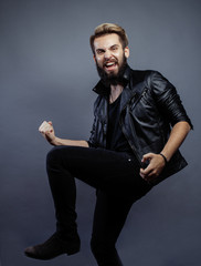 young attractive bearded hipster man gesturing emotional screaming in studio sucsess