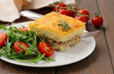 homemade potato gratin with meat and cheese
