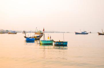 Mui ne beach with many colorful boat