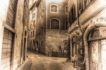 beautiful narrow street in Florence in sepia tone
