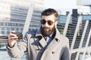 young hipsters businessman take selfie in a modern city
