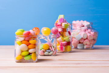 Colorful candy in jar on table selective focus