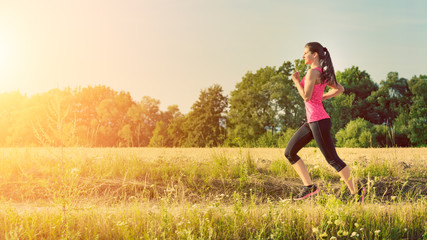 Attractive young female jogging in countryside