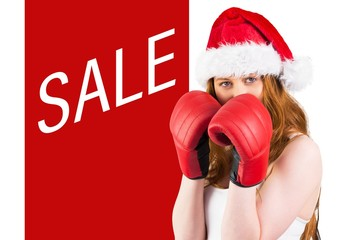 Composite image of festive redhead with boxing gloves