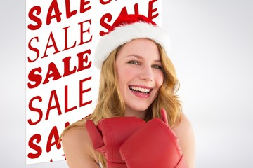 Composite image of smiling blonde wearing red boxing gloves