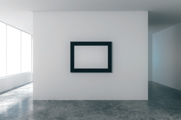Blank picture frame in empty loft room with white walls, city vi