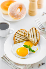 Fried eggs with coffee served for breakfast. Traditional healthy food.