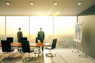 Businessmen in modern sunny conference room with windows in floo