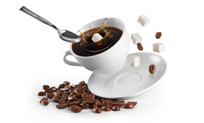 Cup of coffee with coffee beans and sugar on a white background.