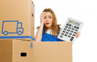 Woman with moving boxes with big calculator