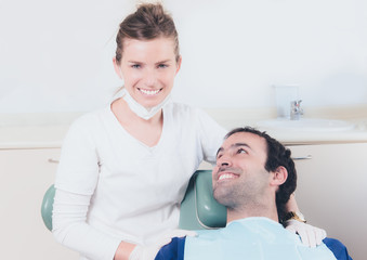 Dentist and her patient with a happy expression.