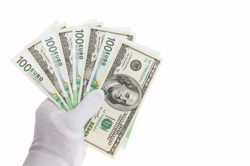 Банкноты в сто евро и сто долларов в руке