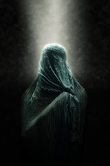 Veiled Islamic woman in a beam of light