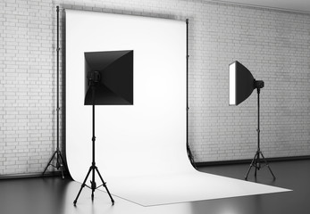 White background lit with Studio equipment against a brick wall.