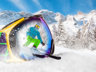 Colorful ski glasses with skier