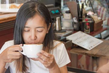Coffee. Beautiful Girl Drinking Tea or Coffee. Beauty Woman enjoying Coffee. Cup of Hot Beverage.