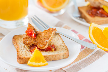Butterfly shaped toast with jam, juice and tea