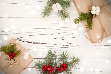 Christmas presents in boxes on a wooden background with copy space. Toned