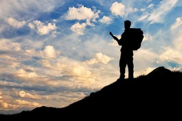 Foto op Aluminium Alpinisme Silhouette climber ascending the mountain