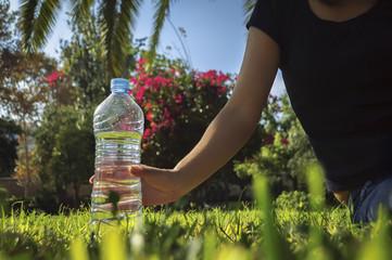 water bottle on grass