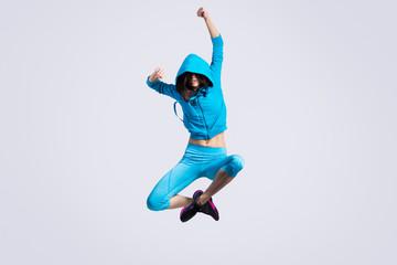Girl jumping in hoodie sweatshirt