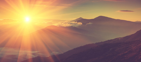 Morning Glory Panoramic view of mountains, autumn landscape with foggy hills at sunrise.