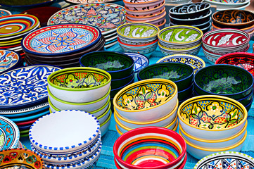 Colorful bowls with ornament on a street market, horizontal view