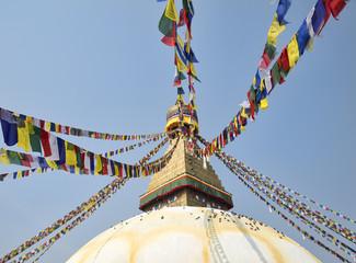 Buddhist stupa Boudnath and colorful prayer flags