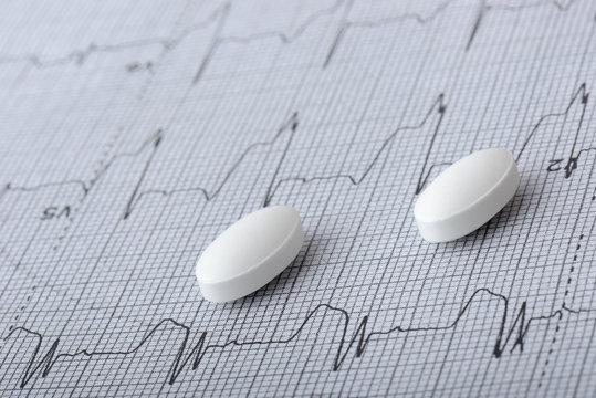 pills on a heart graph
