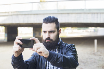 Hipster attractive modern man makes a selfie.