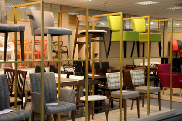 Colored stools and chairs in furniture store