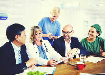 Group Of General Practitioners Having A Meeting