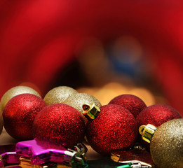 Christmas baubles on wooden table over golden bokeh background