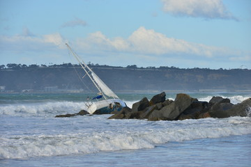 A yacht washed up on a beach in San Diego in Heavy sea's