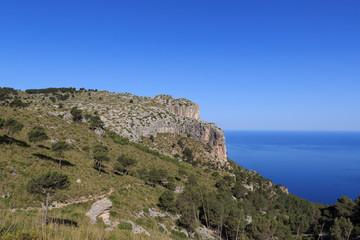 Hiking path in Majorca Tramuntana with Mediterranean Sea in background