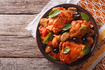 Italian Cacciatori chicken on a plate . horizontal top view