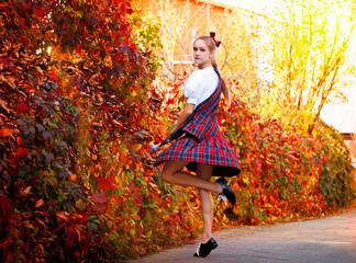 Girl dancing in the Irish dance costume