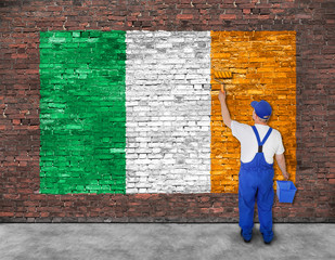 House painter paints flag of Ireland