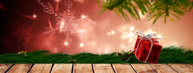 Composite image of christmas hanging decoration