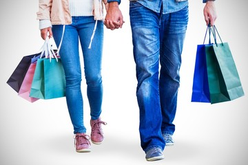 Couple with shopping bags holding hands