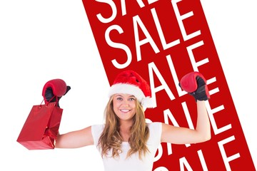 Festive blonde with boxing gloves and shopping bag