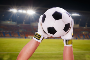 closeup goalkeeper super save on stadium light