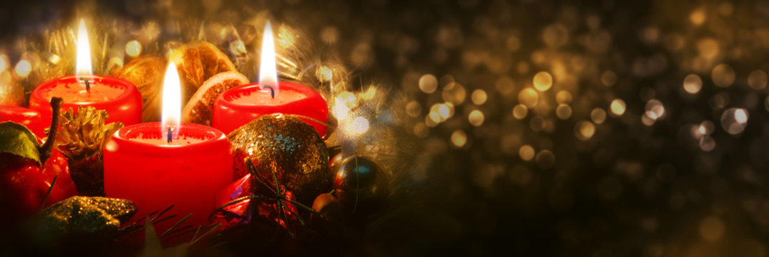 Advent candles with christmas decoration .