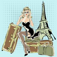 Wall Mural - Beautiful pin-up woman sitting on suitcases near Eiffel Tower Paris