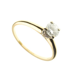 gold and diamond engagement ring isolated on white