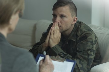 Soldier on consultation with psychoanalyst